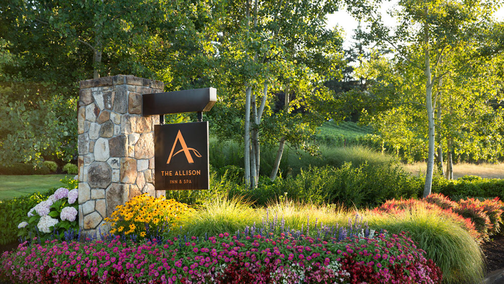 The Allison Inn and Spa Front Entrance Sign with Colorful Flowers