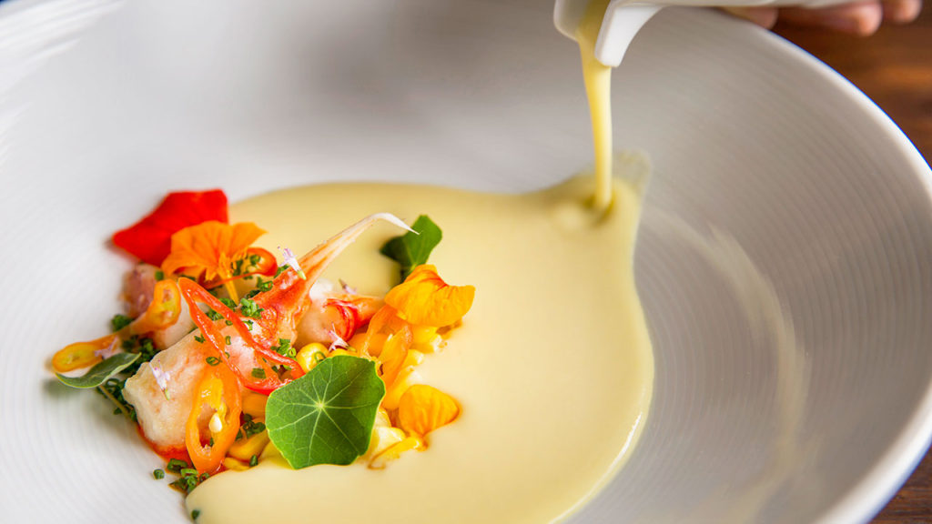 Chilled Sweet Corn Chowder – Dungeness Crab, Pickled Cayenne, Nasturiums