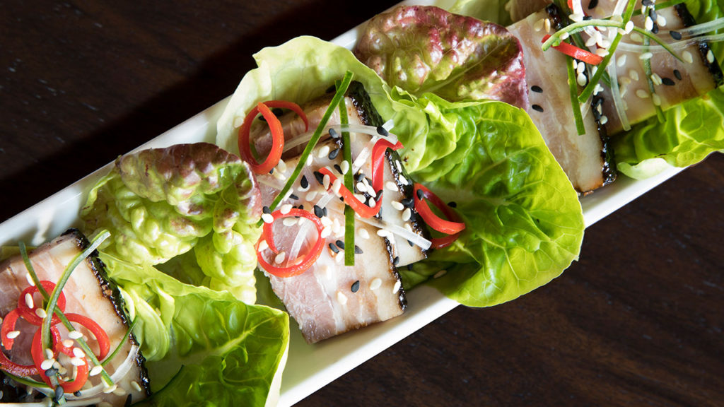 Black Bean-Glazed Pork Belly Wraps – Butter Lettuce, Peppers, Daikon, Leeks, Sesame