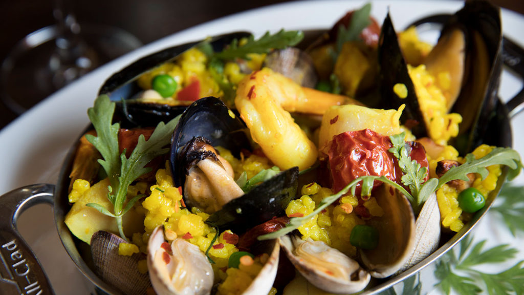 Pacific NW Paella - Valencia Rice, Saffron, Linguiça, Rock Shrimp, Manila Clams, Salt Spring Mussels, Piquillo Peppers