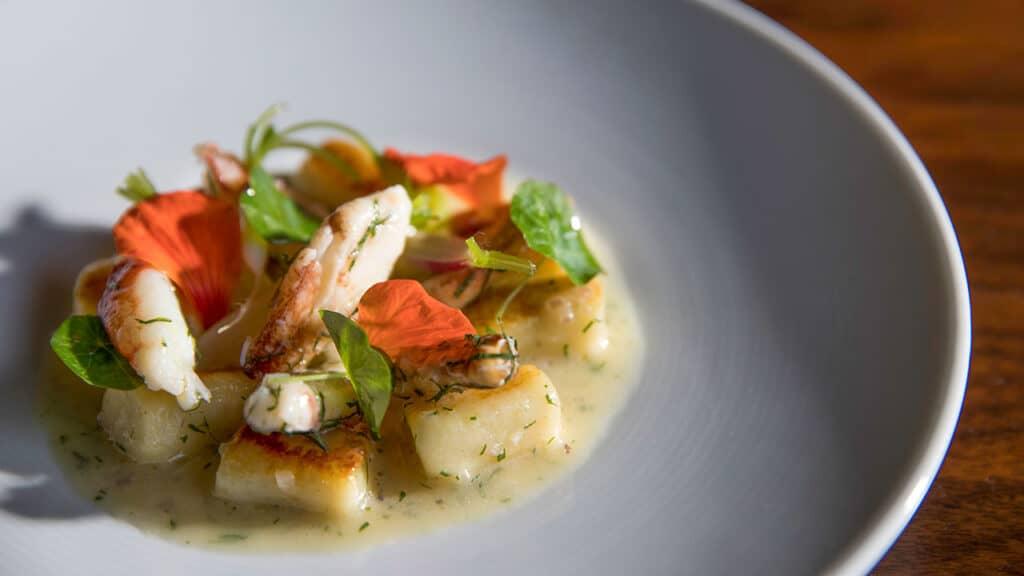 Yukon Gold Potato Gnocchi – Dungeness Crab, Petite Radish, Nasturtium, Champagne-Butter Emulsion