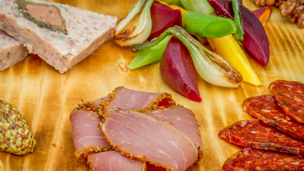 A selection of house-cured charcuterie – garden pickles, mustards