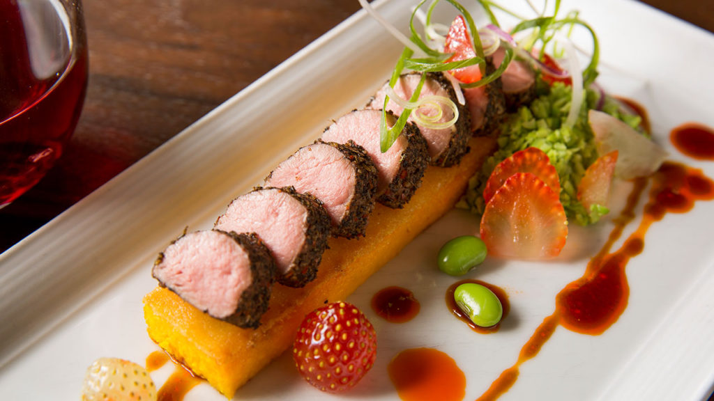Coriander-Crusted Lamb Tenderloin – Sweet Corn Polenta, Edamame, Pickled Strawberries, Harissa-Lamb Jus