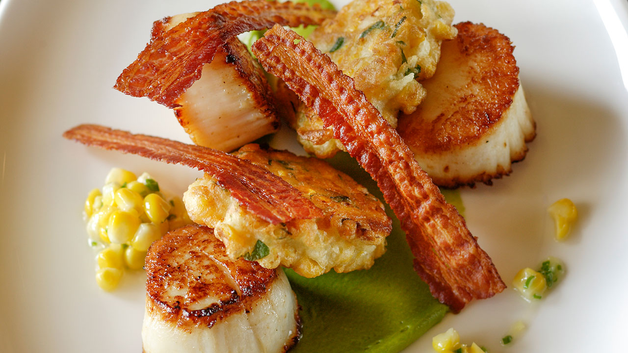 Pan-Seared Diver Scallops – Corn-Lovage Fritter, House-Cured Bacon, Basil Pudding